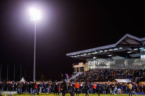Fans of Belfort invade the pitch to celebrate the victory after the French Cup soccer match between Belfort and Montpellier on January 28, 2020 in...