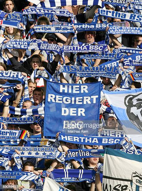 Fans of Berlin are seen prior to the Bundesliga match between Hertha BSC Berlin and FC Energie Cottbus at the Olympic stadium on September 27 2008 in...