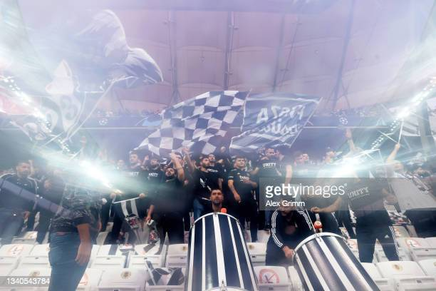 Fans of Besiktas wave flags prior to the UEFA Champions League group C match between Besiktas and Borussia Dortmund at Vodafone Park on September 15,...