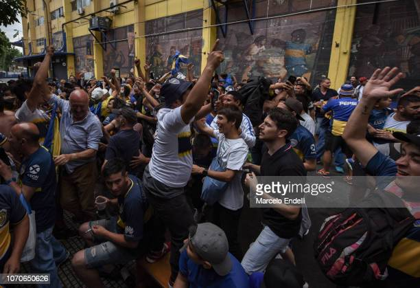 Fans of Boca Juniors celebrate the goal of their team as they watch a broadcast of the final against River Plate in La Boca during the second leg of...