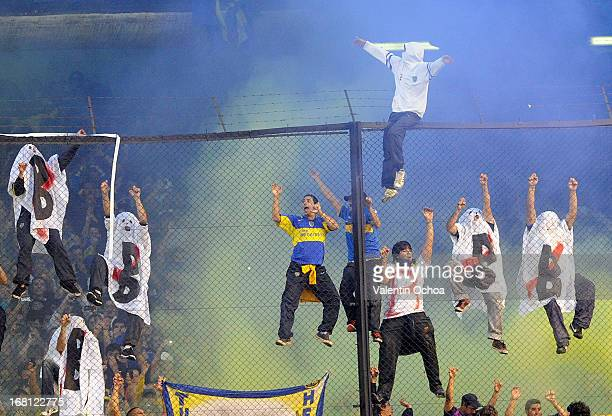 Fans of Boca Juniors celebrates a goal during a match between Boca Juniors and River Plate as part of the Torneo Final 2013 at the Alberto J Armando...