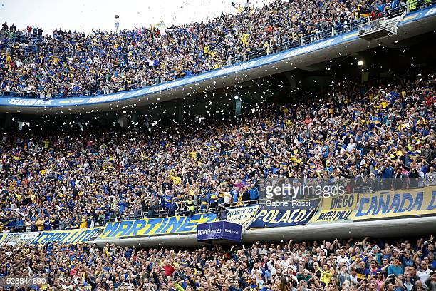 Fans of Boca Juniors cheer for their team before a match between Boca Juniors and River Plate as part of Torneo Transicion 2016 at Alberto J Armando...