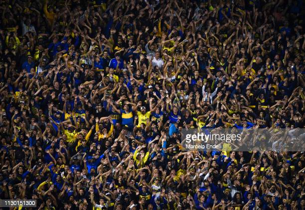 Fans of Boca Juniors cheer for their team during a group G match between Boca Juniors and Deportes Tolima as part of Copa CONMEBOL Libertadores 2019...