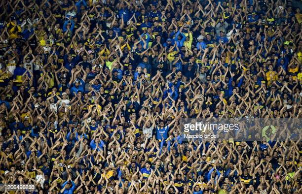 Fans of Boca Juniors cheer for their team during a Group H match between Boca Juniors and Deportivo Independiente Medellin as part of Copa CONMEBOL...