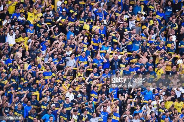 Fans of Boca Juniors cheer for their team during a match between Boca Juniors and Patronato as part of Superliga 2018/19 at Estadio Alberto J Armando...
