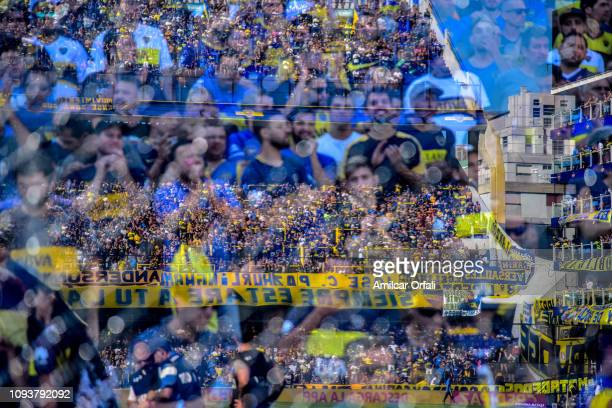 Fans of Boca Juniors cheer for their team during a match between Boca Juniors and Godoy Cruz as part of Superliga 2018/19 at Estadio Alberto J...