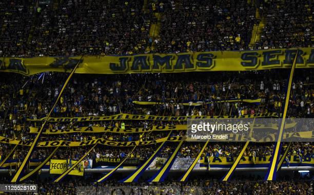 Fans of Boca Juniors cheer for their team during a match between Boca Juniors and Lanus as part of Superliga 2018/19 at Estadio Alberto J Armando on...
