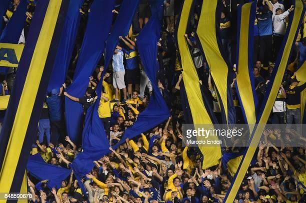 Fans of Boca Juniors cheer for their team during a match between Boca Juniors and Godoy Cruz as part of Superliga 2017/18 at Alberto J Armando...
