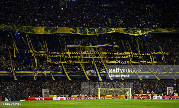 Fans of Boca Juniors cheer for their team during a second leg semifinal match between Boca Juniors and Argentinos Juniors as part of Copa de la...