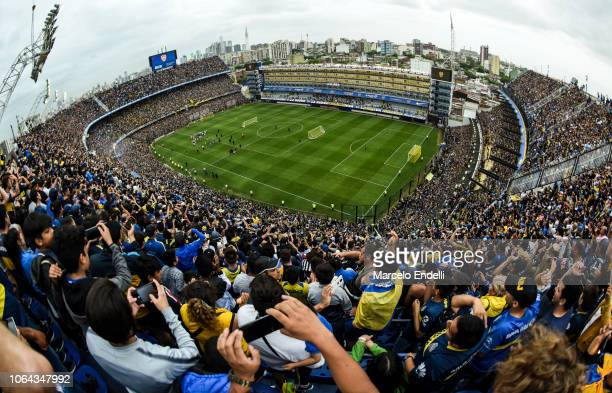Fans of Boca Juniors cheer for their team during an open training session ahead of the final match of Copa CONMEBOL Libertadores 2018 at Estadio...
