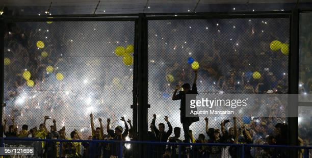 Fans of Boca Juniors cheer for their team during the celebration event after winning the Argentina Superliga 2017/18 at Estadio Alberto J Armando on...