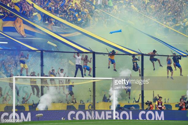 Fans of Boca Juniors cheer for their team during the first leg match between Boca Juniors and River Plate as part of the Finals of Copa CONMEBOL...