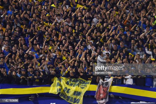 Fans of Boca Juniors cheer for their team during the Semifinal second leg match between Boca Juniors and River Plate as part of Copa CONMEBOL...