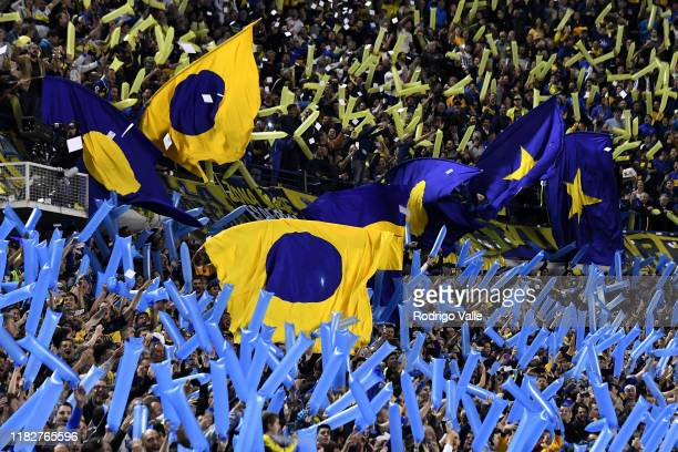 Fans of Boca Juniors cheer for their team prior the Semifinal second leg match between Boca Juniors and River Plate as part of Copa CONMEBOL...