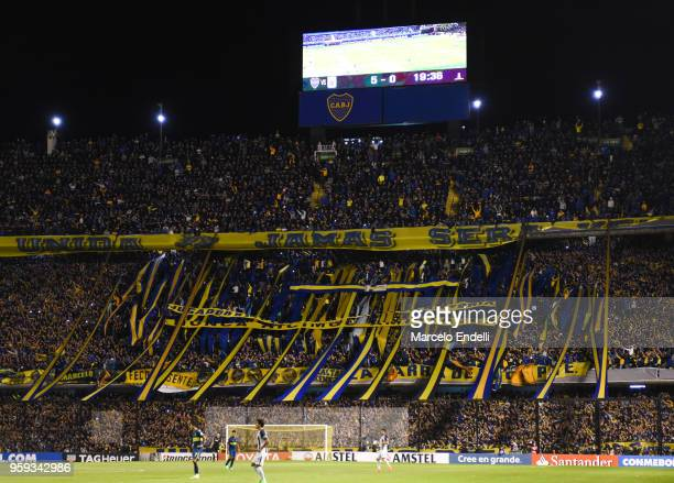 Fans of Boca Juniors cheer their team during a match between Boca Juniors and Alianza Lima at Alberto J Armando Stadium on May 16 2018 in La Boca...