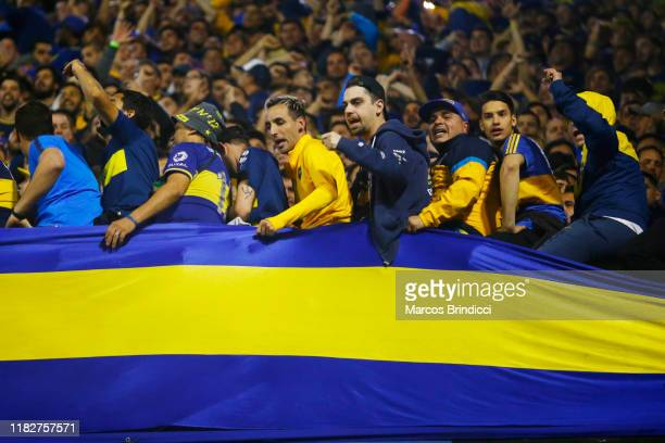 Fans of Boca Juniors cheer their team prior to the Semifinal second leg match between Boca Juniors and River Plate as part of Copa CONMEBOL...