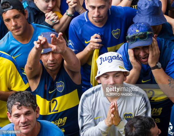 Fans of Boca Juniors in Buenos Aires' La Boca neighbourhood gesture as they watch the second leg match of the allArgentine Copa Libertadores final...