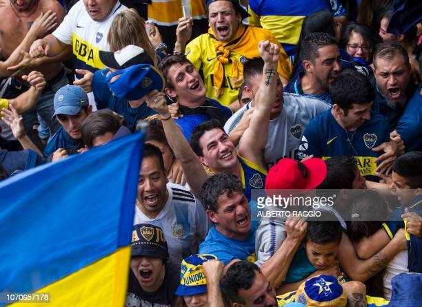 Fans of Boca Juniors in Buenos Aires' La Boca neighbourhood react as they watch the second leg match of the allArgentine Copa Libertadores final...