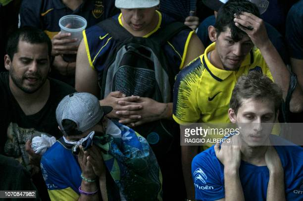 Fans of Boca Juniors in Buenos Aires' La Boca neighbourhood react after their team loses the second leg match of the allArgentine Copa Libertadores...