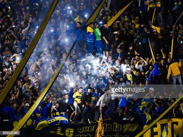 Fans of Boca Juniors light flares to celebrate after winning a match between Boca Juniors and Alianza Lima at Alberto J Armando Stadium on May 16...