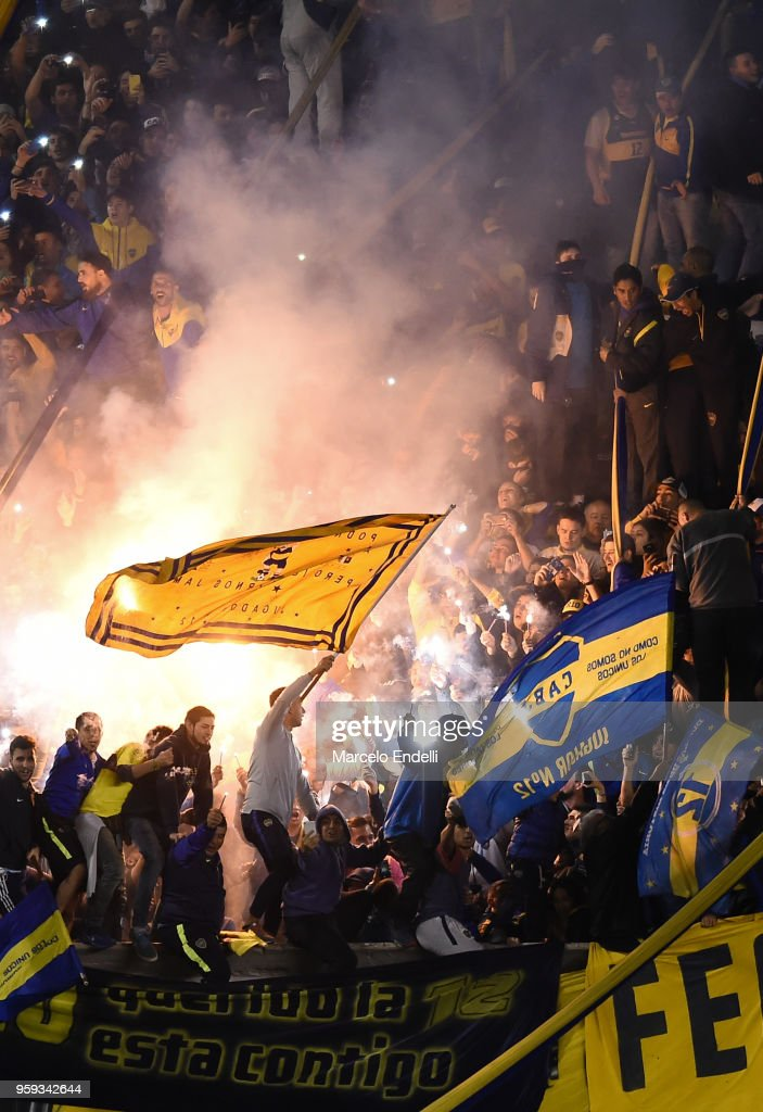 Fans of Boca Juniors light flares to celebrate after winning a match between Boca Juniors and Alianza Lima at Alberto J. Armando Stadium on May 16, 2018 in La Boca, Argentina.