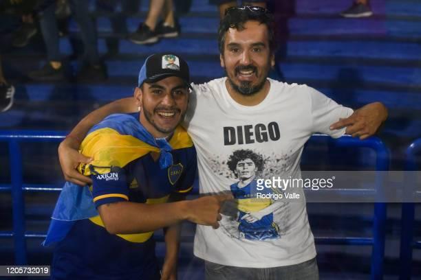 Fans of Boca Juniors shows a shirt of Diego Maradona during a match between Boca Juniors and Gimnasia as part of Superliga 2019/20 at Estadio Alberto...