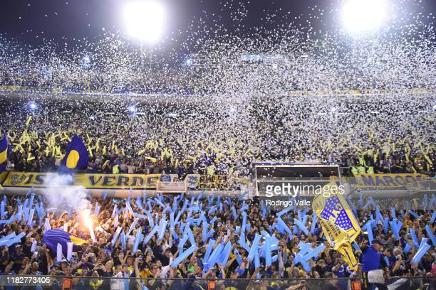 Fans of Boca Juniors throw papers to receive their team prior the Semifinal second leg match between Boca Juniors and River Plate as part of Copa...