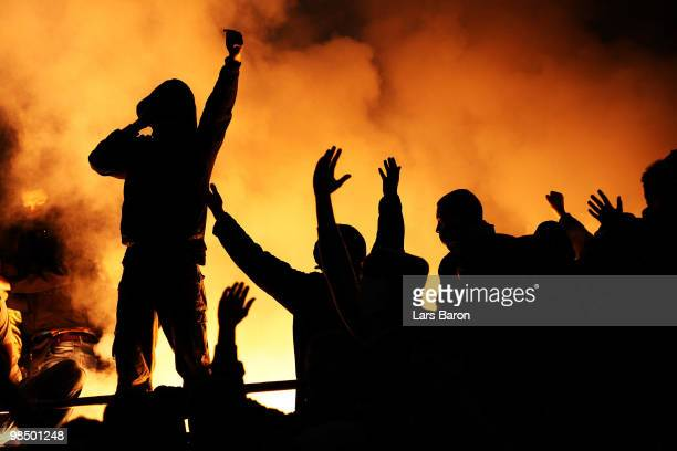 Fans of Bochum are seen with fireworks during the Bundesliga match between 1 FC Koeln and VfL Bochum at RheinEnergieStadion on April 16 in Cologne...
