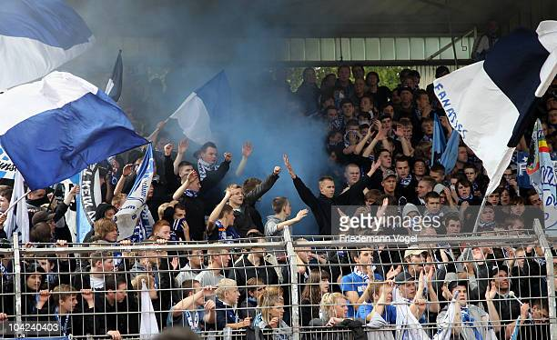 Fans of Bochum lighting flares during the Second Bundesliga match between RW Oberhausen and VfL Bochum at the Niederrhein Stadium on September 18...