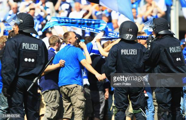Fans of Bochum strom the pitch after the Second Bundesliga match between VfL Osnabrueck and VfL Bochum at Osnatel Arena on May 8 2011 in Osnabruck...