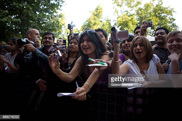 Fans of Bollywood superstar Shah Rukh Khan show their excitement as he arrives at Somerset House in London for the world premiere of his new film...