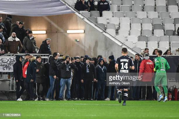Fans of Bordeaux on the pitch during the Ligue 1 match between Bordeaux and Nimes at Stade Matmut Atlantique on December 3, 2019 in Bordeaux, France.