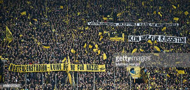 Fans of Borussia Dortmund demonstrate against racism during the Bundesliga match between Borussia Dortmund and FC Bayern Muenchen at Signal Iduna...