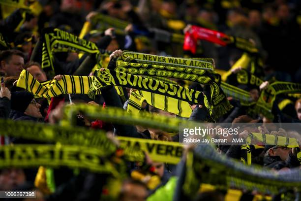 Fans of Borussia Dortmund hold up scarves during the Group A match of the UEFA Champions League between Borussia Dortmund and Club Brugge at Signal...