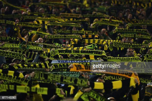 Fans of Borussia Dortmund hold up their scarfs prior to the UEFA Champions League group H match between Borussia Dortmund and Tottenham Hotspur at...