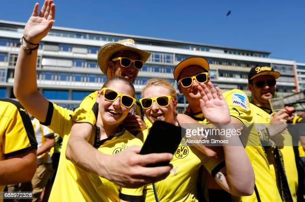 Fans of Borussia Dortmund show their support at the Breitscheidplatz prior to the DFB Cup Final match between Eintracht Frankfurt and Borussia...