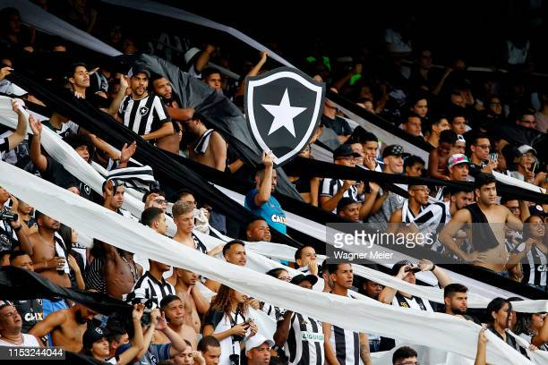 Fans of Botafogo cheer their team during a match between Botafogo and Vasco da Gama as part of the Brasileirao Series A championship at Engenhao...