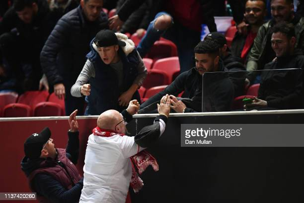 Fans of both teams clash during the U21 International Friendly match between England and Poland at Ashton Gate on March 21 2019 in Bristol England