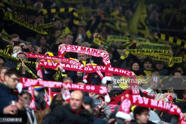 Fans of both teams hold up their scarves and sing 'You'll never walk alone' prior to the Bundesliga match between Borussia Dortmund and 1 FSV Mainz...