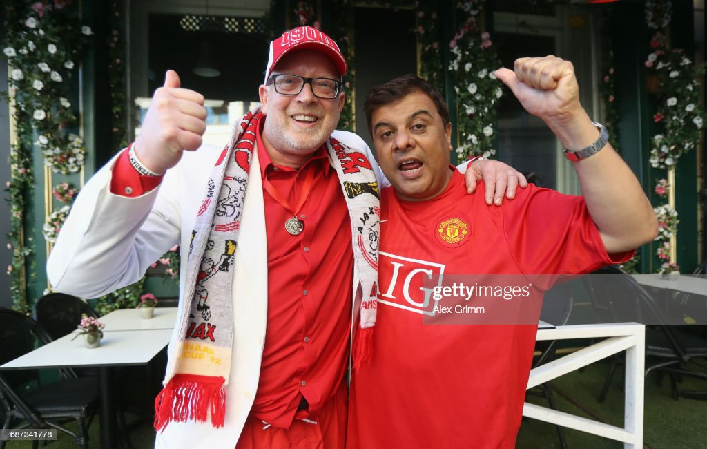 Fans of both teams pose on the day before the UEFA Europa League Final between Ajax Amsterdam and Manchester United on May 23, 2017 in Stockholm, Sweden.