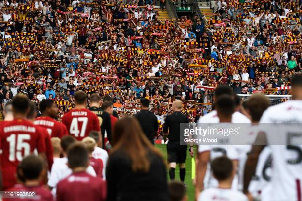Fans of Bradford City show their support as the teams walk on to the pitch during the PreSeason Friendly match between Bradford City and Liverpool at...