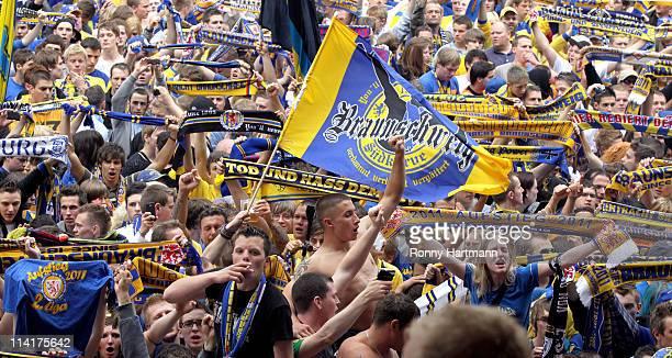 Fans of Braunschweig celebrate promotion to the Second Bundesliga after the Third League match between Eintracht Braunschweig and 1. FC Heidenheim at...