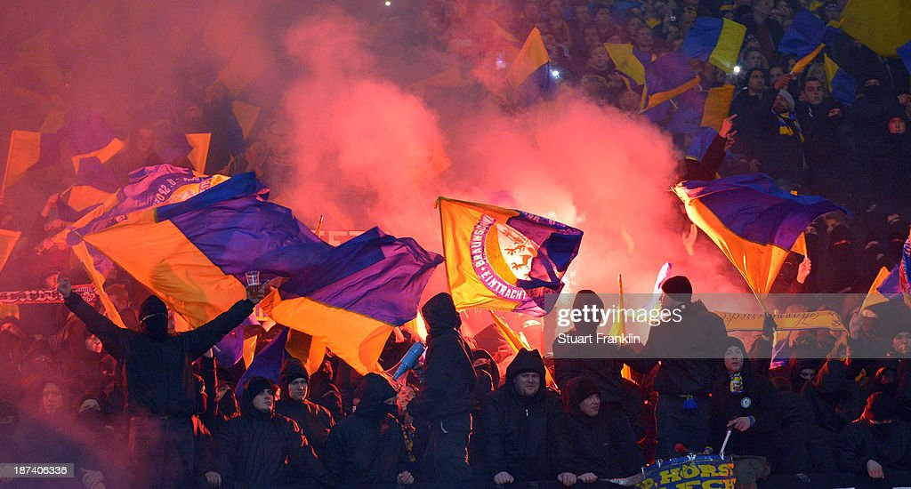 Fans of Braunschweig hold flares during the Bundesliga match between Hannover 96 and Eintracht Braunschweig at HDI-Arena on November 8, 2013 in Hanover, Germany.