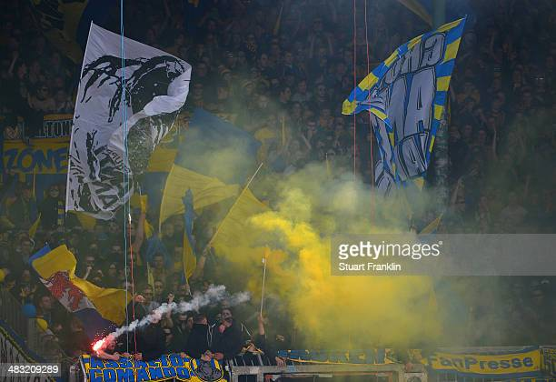 Fans of Braunschweig support their team with flares during the Bundesliga match between Eintracht Braunschweig and Hannover 96 at Eintracht Stadion...