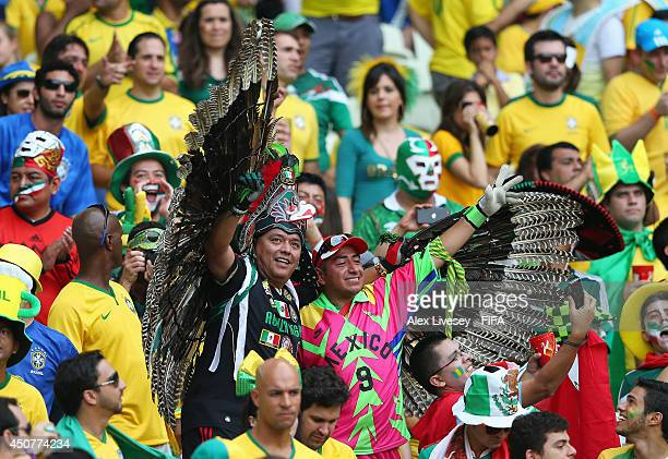 Fans of Brazil and Mexico soak up the atmosphere prior to the 2014 FIFA World Cup Brazil Group A match between Brazil and Mexico at Estadio Castelao...