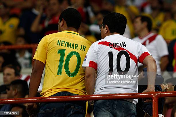 Fans of Brazil and Peru show their jerseys prior to a match between Peru and Brazil as part of FIFA 2018 World Cup Qualifiers at Nacional Stadium on...