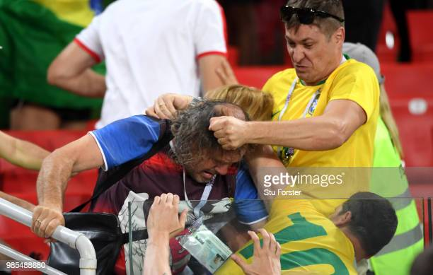 Fans of Brazil and Serbia fight in the stabds following during the 2018 FIFA World Cup Russia group E match between Serbia and Brazil at Spartak...