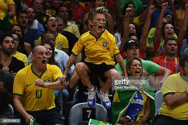 Fans of Brazil cheer on their team during the Women's Quarterfinal match between China and Brazil on day 11 of the Rio 2106 Olympic Games at the...
