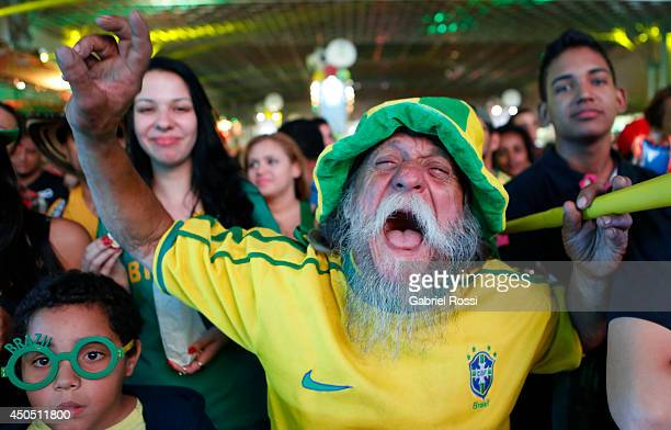 Fans of Brazil during the FIFA Fan Fest for the opening game of the FIFA World Cup 2014 between Brazil and Croatia at ExpoMinas on June 12, 2014 in...