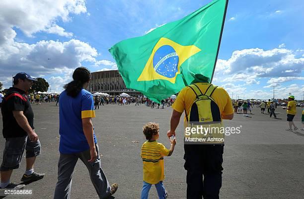 Fans of Brazil hold a flag outside the National Stadium / Estadio Nacional Mane Garrincha in Brasilia, Brazil